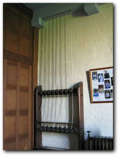 The Ellacombe Chimes ropes in the church Porch. The frame holds the eight ropes leading up to the bell chamber.